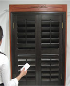 Motorized wood shutters